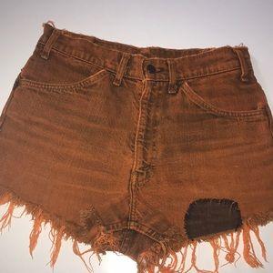 Orange dyed vintage Levi's cutoff shorts.
